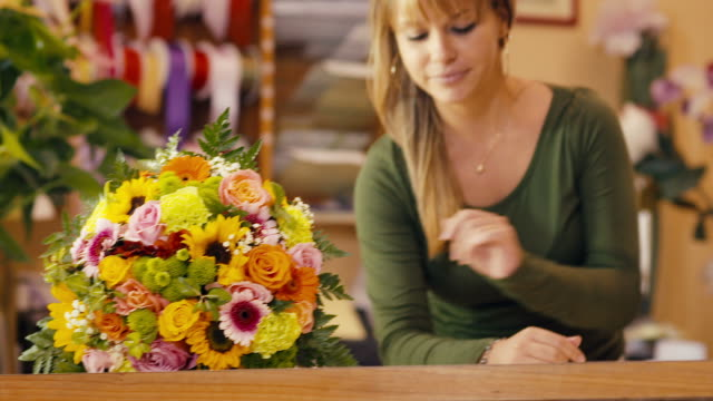 happy woman working as florist in flower shop video