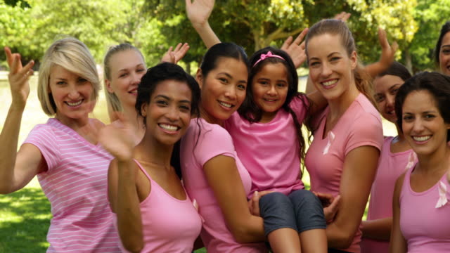 Happy women in pink for breast cancer awareness video