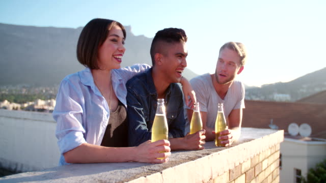 Happy young adult friends meets on the rooftop after work video