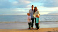 Happy Young Caucasian Family Posing on Sandy Beach video