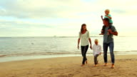 Happy Young Caucasian Family Walking video