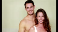 Happy young couple embracing together video