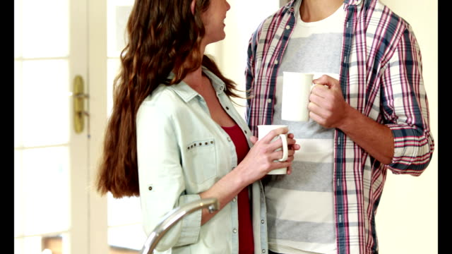 Happy young couple having coffee video