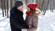 Happy Young Couple in Winter Park, slowmotion video