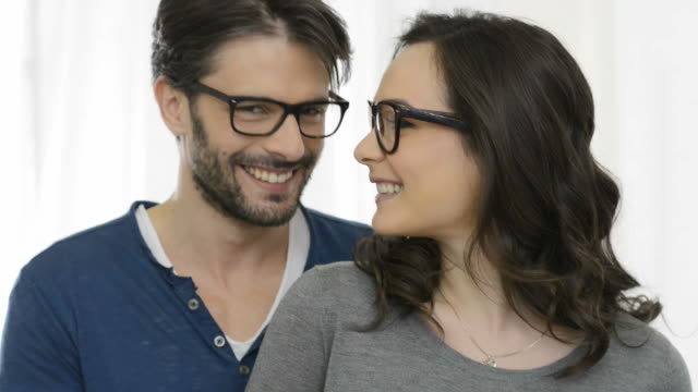 Happy young couple with specs video