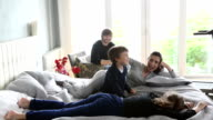 Happy young family having fun together in bed video