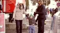 Happy young family on a ski resort in winter. video