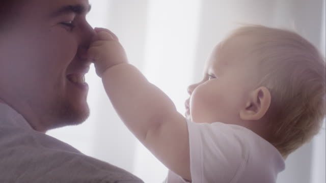 Happy young father playing with baby video