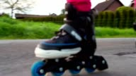 Happy young girl riding on roller blades video