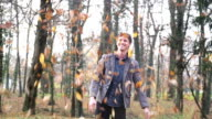 Happy young man throwing leaves in the air video