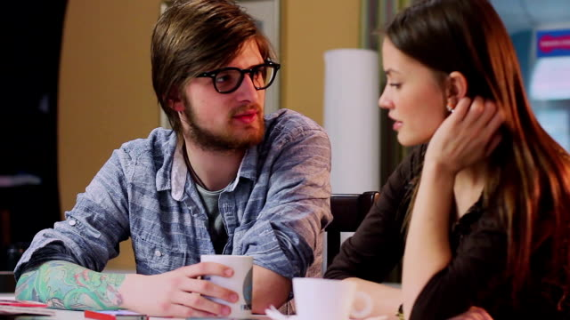 Happy young man woman couple chatting drinking coffee restaurant video