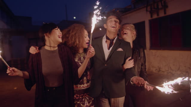 Happy young people celebrating new years eve video