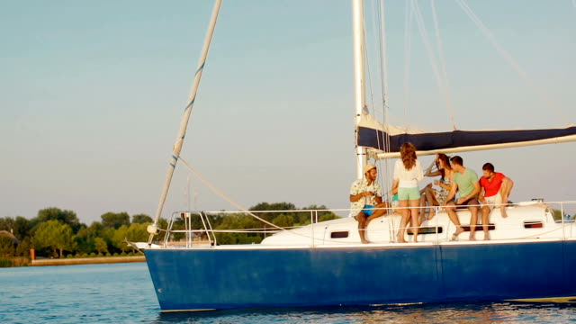Happy young people sailing on the yacht. video