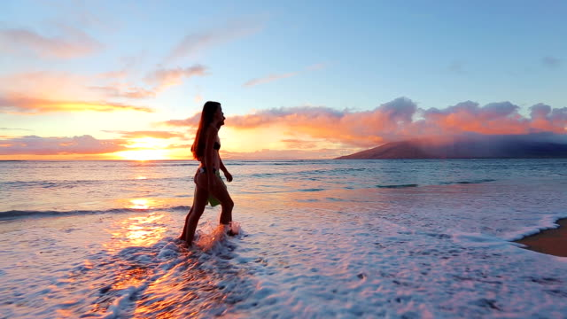 Happy Young Romantic Couple Walking on the Beach Enjoying the Sunset video
