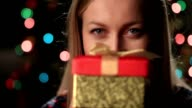 Happy young woman holding christmas present box video