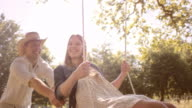 SLO MO Happy woman on a swing video