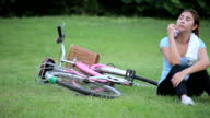 Happy Young Woman riding bicycle outside video