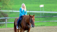 Happy young woman riding the horse video