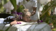 Happy young woman smiling during massage in spa video