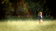Happy Young Woman Twirls In A Circle, And Smells A Flower video