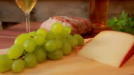 Hard cheese with white wine. grapes and bread video