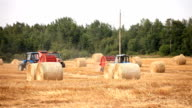 harvester. tractor makes bales of straw video