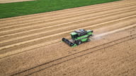 AERIAL: Harvesting a Field of Wheat video