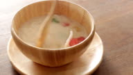 Having dessert with water chestnut in coconut cream video