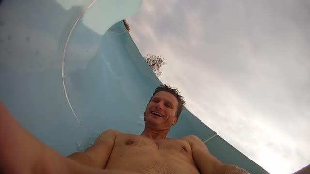 HD SLOW MOTION: Having Fun On A Winding Waterslide video