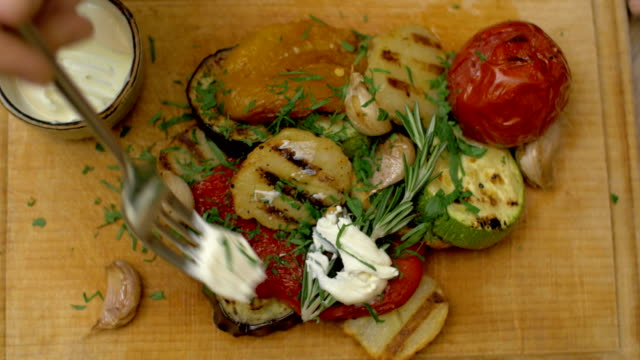 Having meal with grilled vegetables video