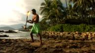Hawaiian fire knife dancer performs video