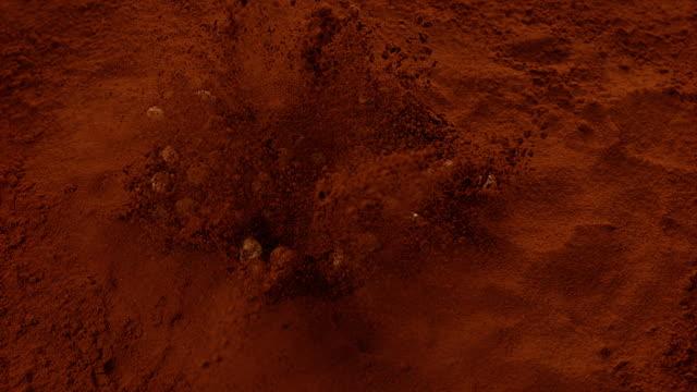 Hazelnuts Falling in Black Chocolate Powder, Slow Motion 4K video