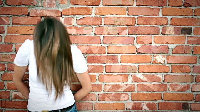 hd girl portrait in front of bricks wall with copyspace video