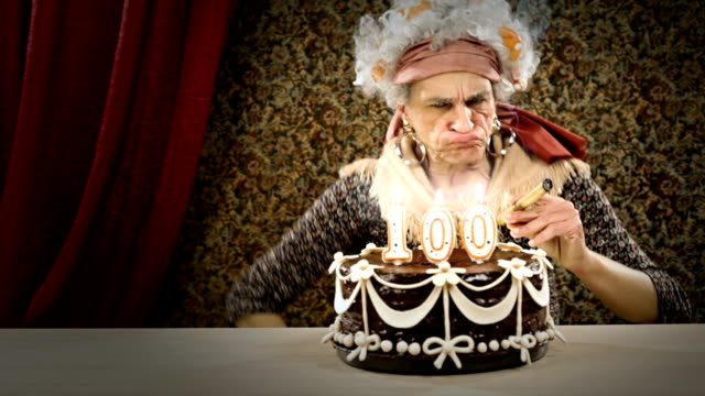 hd video funny senior lighting a cigar  birthday candle video