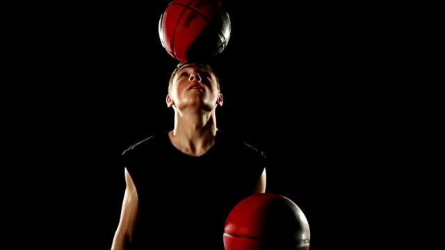 hd video young champion acrobatic basketball plays black background freestyle video
