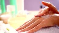 HD1080:Applying skin moisturizer onto hands. video
