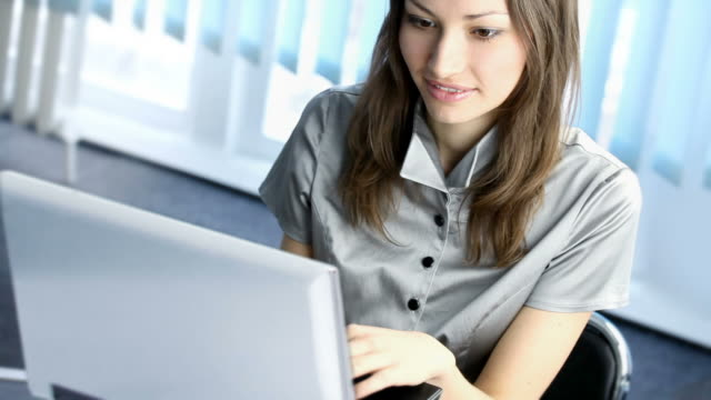 HD1080p30: Happy businesswoman working with laptop at office, tripod video