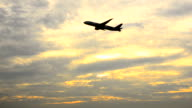 HD:Airplane taking off from airport at sunset time video