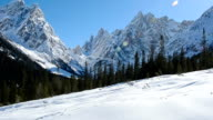 HD:Alpinist snowshoeing in the mountains video