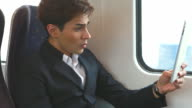 HD:Angry businessman using tablet during his trip.. video
