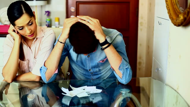 HD:Annoyed couple calculating their finances during recession. video