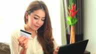 HD:Asian cute women shopping online. video