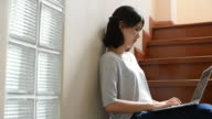 HD:Asian girl working with laptop at home video