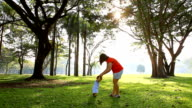 HD:Asian mother helping baby walk in the park. video