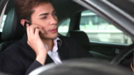 HD:Asian young businessman driving talking on mobile phone. video