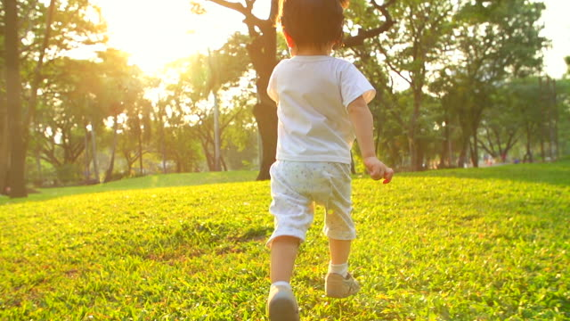 HD:Baby boy running at the park during sunset. video
