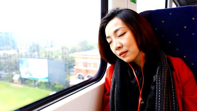HD:Beautiful asian women sleeping on the train. video