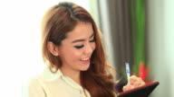 HD:Beautiful asian women taking note on notebook. video
