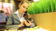 HD:Beautiful businesswoman on her lunch inside at the coffee shop. video