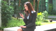 HD:Beautiful businesswoman using a cellular phone. video